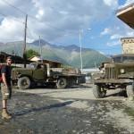 Posing with Soviet trucks